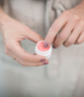 woman holding lip balm