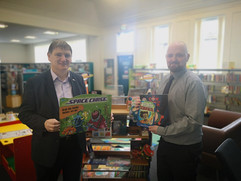 Peter donating Summer Reading Challenge 2019 books to Methil Library