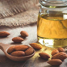 almond-oil-and-almonds-1296x728_edited.j