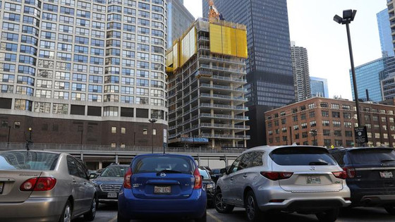 Parking lots disappearing in ride-sharing era as downtown construction booms