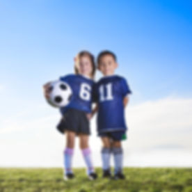 Two cute youth soccer players wearing th