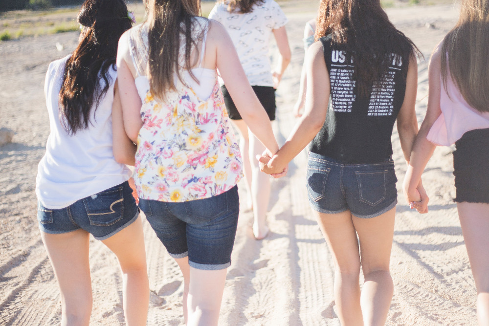 young women on a beach together