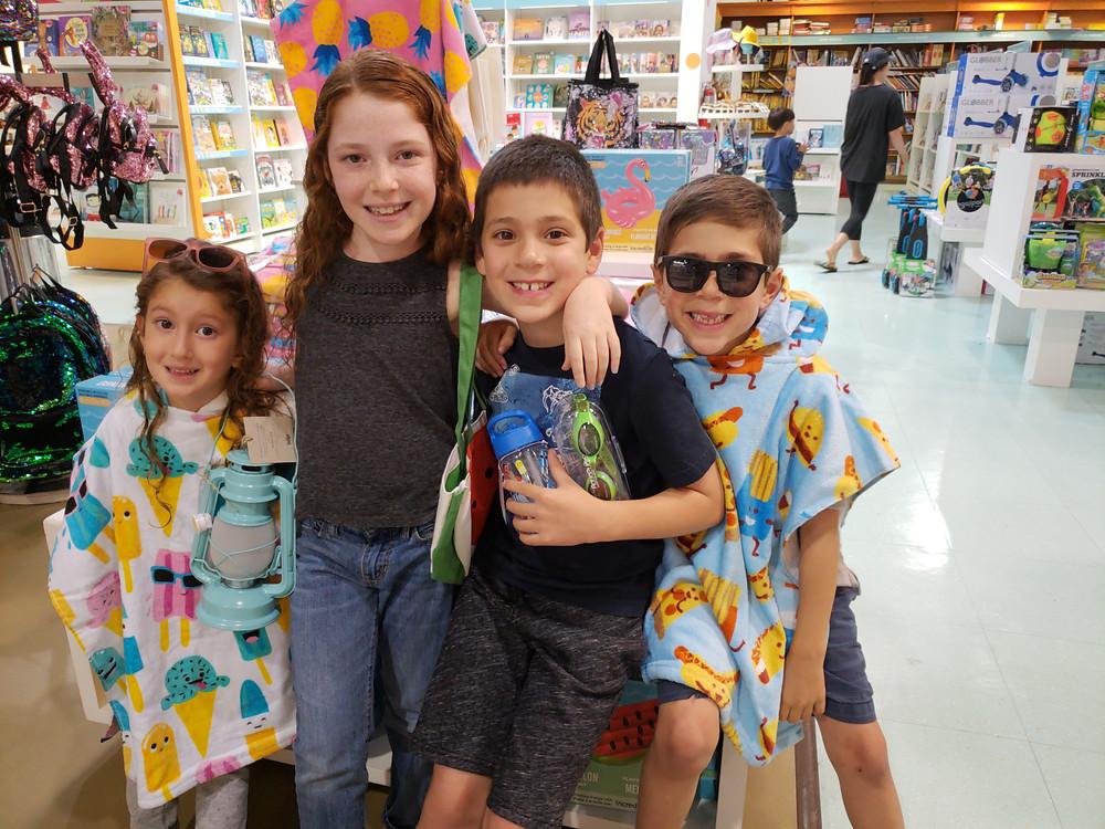 kids wearing summer camp supplies