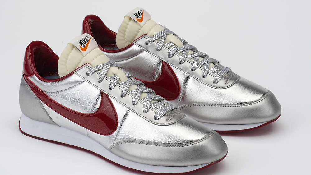 The silver disco shoes with a smooth rubber bottom with sparkles- Pure Performance
