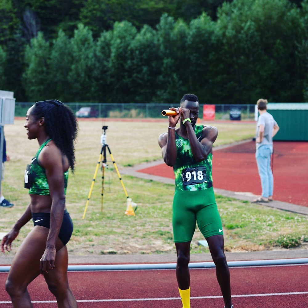 Chanelle Price and Nigel Amos preparing for a 2x2x400 meter mixed gender relay