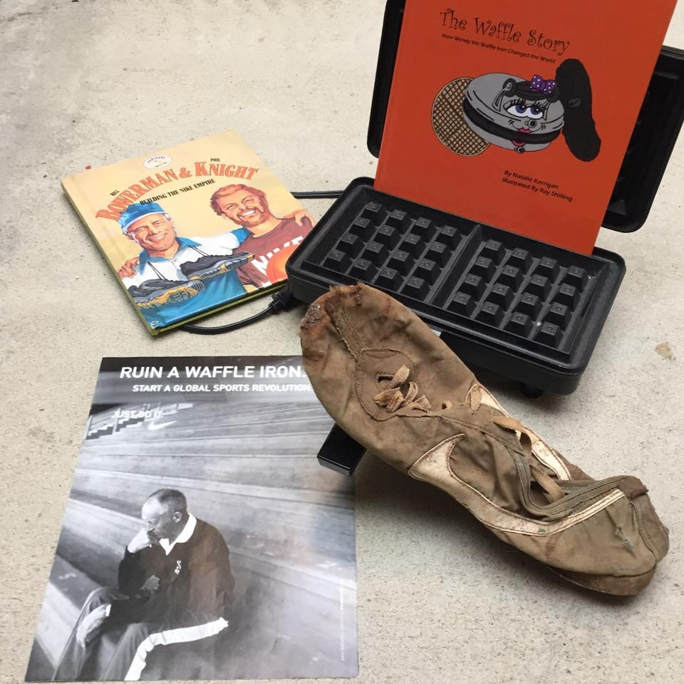 Bill Bowerman's first waffle running shoe and a replica of the waffle iron he destroyed at home making the product.
