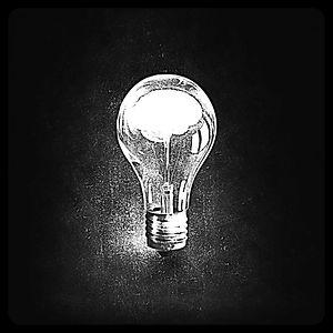 Human brain glowing inside of light bulb