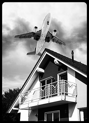 Airplane flying at low altitude over a h