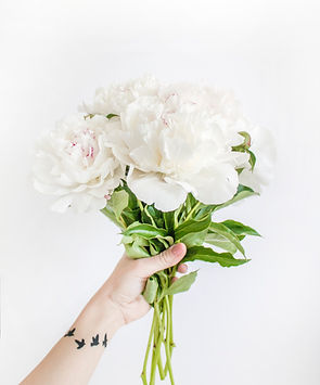 person-holding-white-peony-bouquet-close