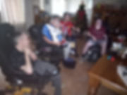 Four men in wheelchairs playing video games