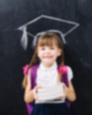 Child-Student-Holding-Books-Blackboard.j