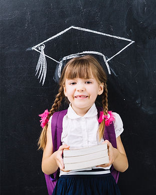 Child-Student-Holding-Books-Blackboard.j