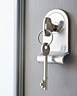 Close up image of keys and a lock with keys in a door lock