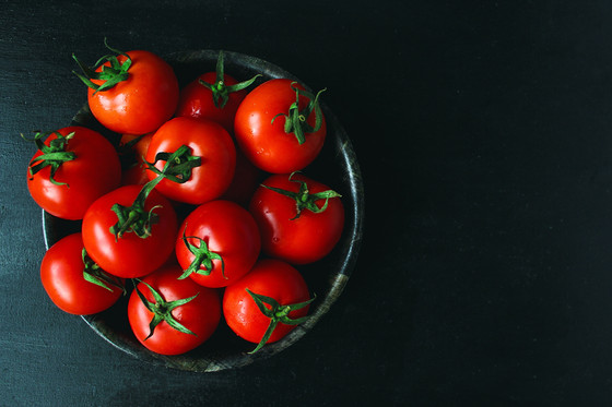 Baked tomatoes with fresh herbs and olive oil