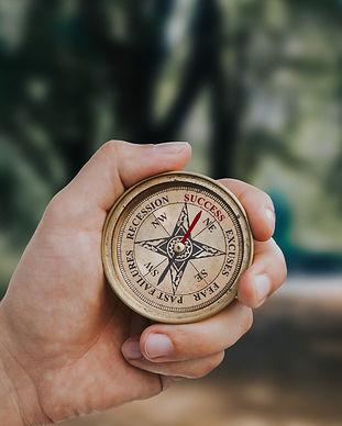 9972_10996_Hand_Holding_Success_Compass-