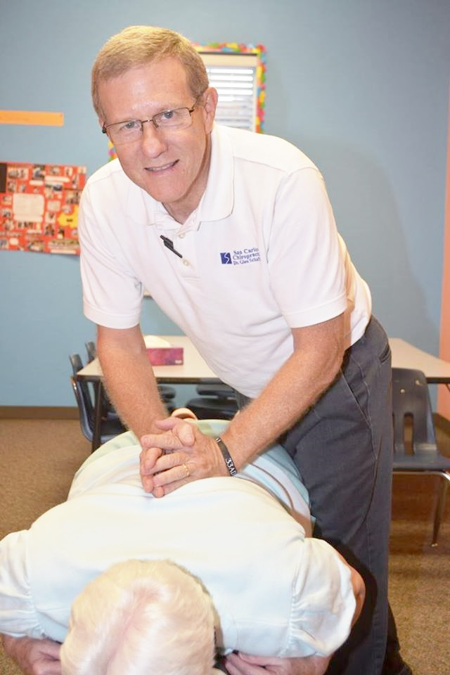 A volunteer with patient at SWFL Free Pain Clinic