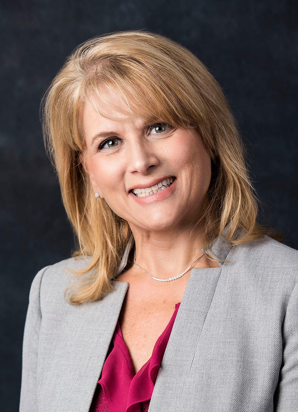 Karen Anderson, President of the Board