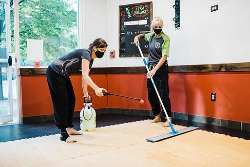Disinfecting the studio floor