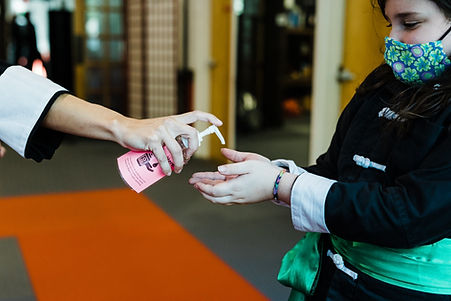 Strict COVID-19 precautions include hand sanitizer