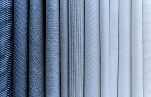 pile-of-textiles-background_53876-88930.