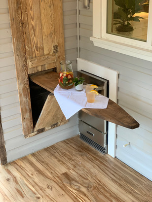 Early 1900's ironing board turned serving table