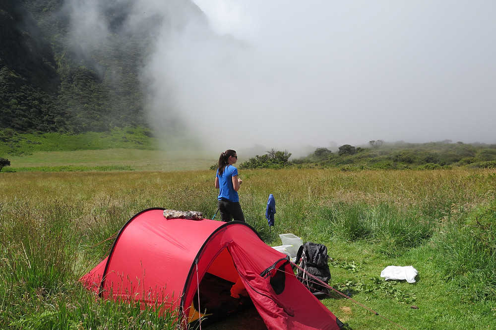 Katie watching the clouds roll in at Palikū camp in Haleakalā National Park Crater