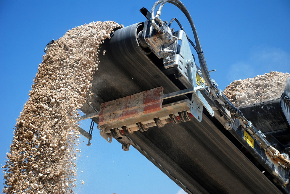 aggregate production by mobile crusher. Conveyor belt of a working mobile crusher machine,