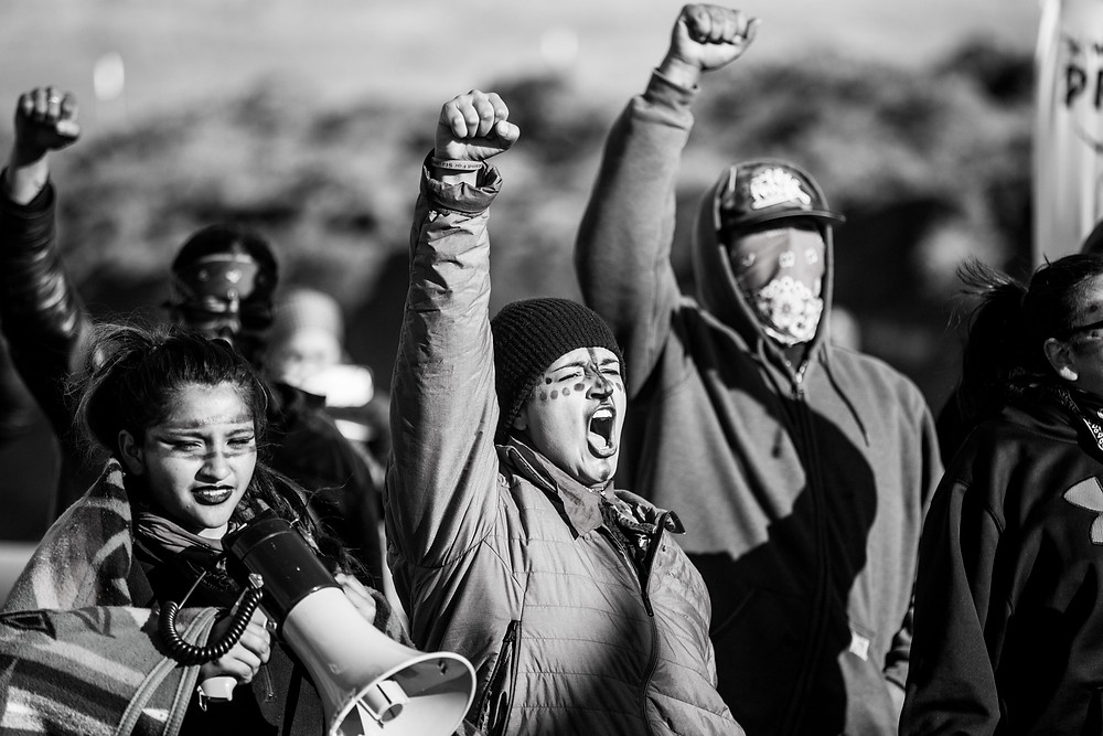 Tasina Sapa Win, middle, protecting her people's territory during the Standing Rock movement. Pic courtesy of Adam Alexander Johansson.