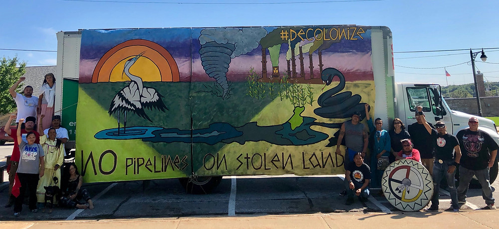 Resistance Art that Trisha helped create for Indigenous Iowa and Bold Iowa during the First Nation - Farmer Climate Unity March in 2018.