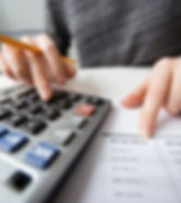 closeup-of-accountant-hands-counting-on-