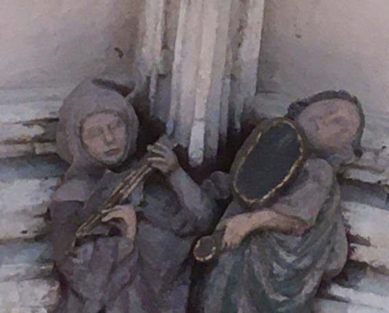 Another wonderful boss from the Norwich Cathedral cloister, again likely fourteenth century, of a very joyful pair of minstrels on citole and some kind of vielle.