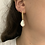 Thumbnail: עגילי פנינה פראית תלויים