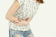 Woman having painful stomachache, chroni
