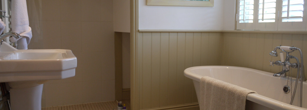 Main bathroom with shower and bath