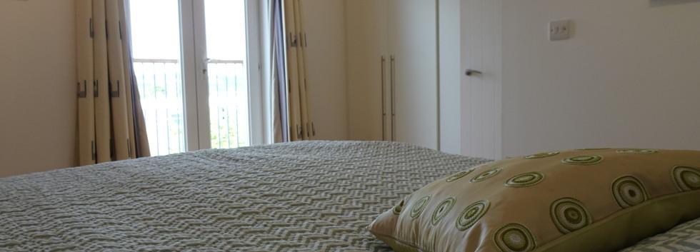 Main bedroom with balcony.JPG