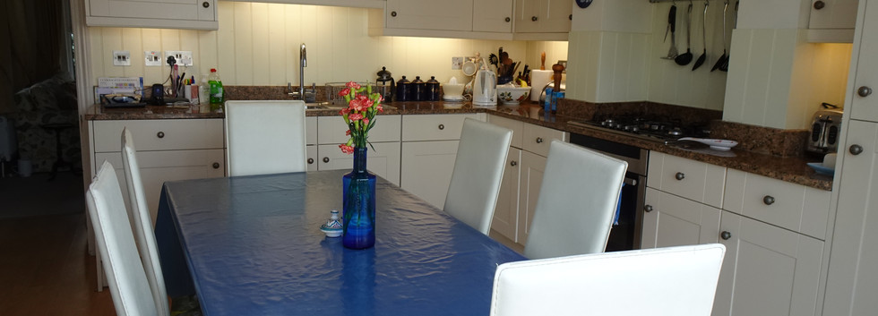 Kitchen with dining table.JPG