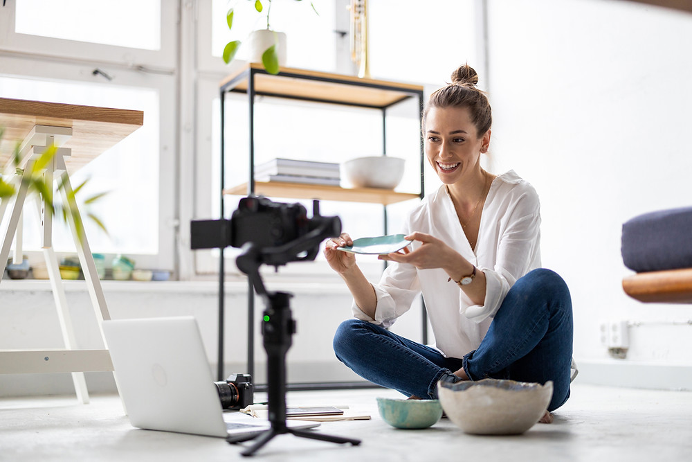 Business owner recording a video of her ceramic bowls