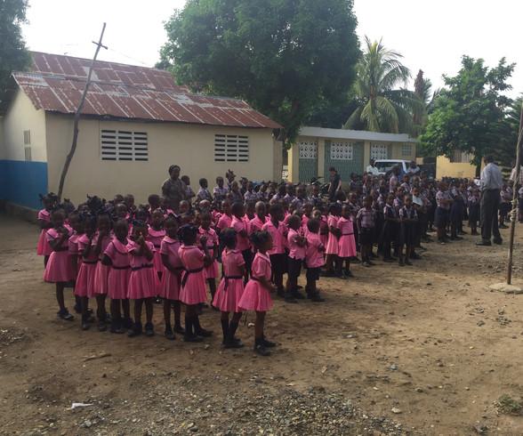 Children line up for school