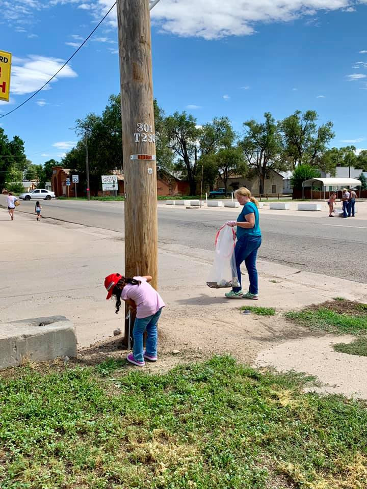 Volunteers collecting trash along Elm Avenue in Rocky Ford, CO.