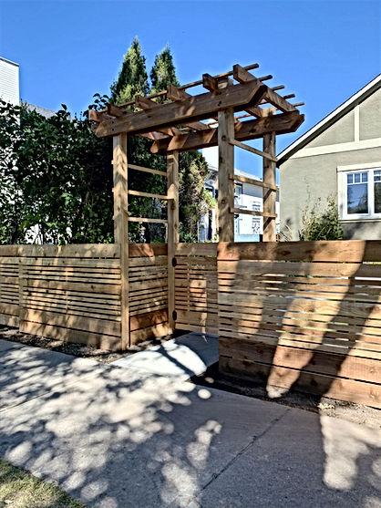 Rough cedar Arbour matched with a horizontal cedar fence