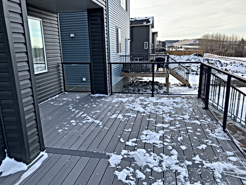Fiberon Decking matched with clear glass railing