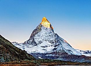 Switzerland. Alpenglow on Matterhorn pea