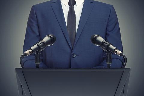 Businessman or politician making speech