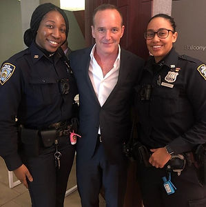 Clark Gregg with police officers
