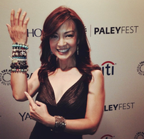Ming-Na sharing the bracelets she received from fans at Paley Fest 2014
