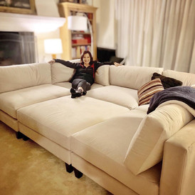 Ming-Na with her new supersize sofa from Eric