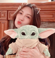 Ming-Na with her Baby Yoda, a gift from Eric