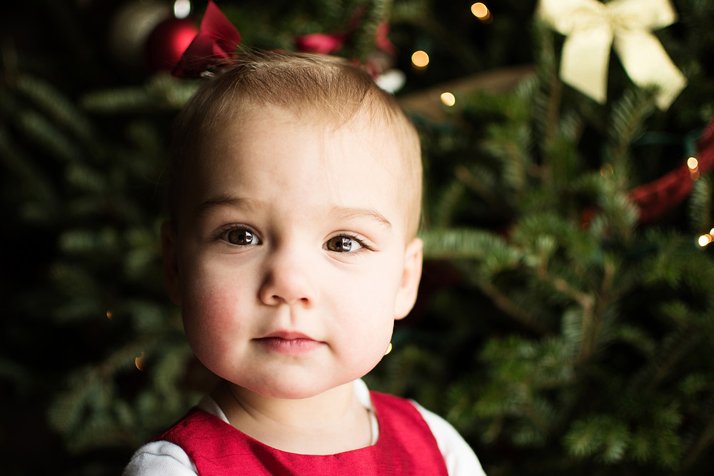 toddler with Christmas tree