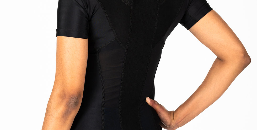 Woman wearing a black zipper version of the Posture Shirt to improve posture