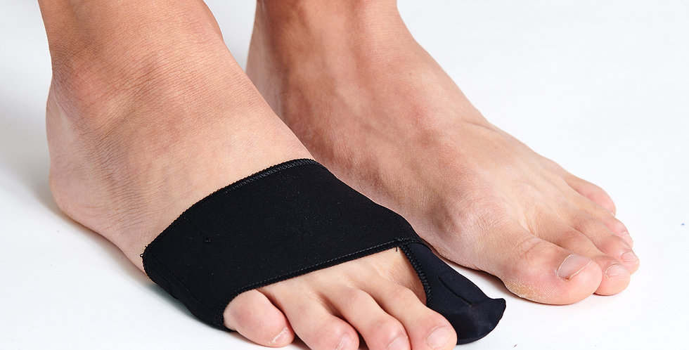Close up on a pair of feet with one foot wearing the Epitact Bunion Day Corrector a bunion brace that fits inside shoes